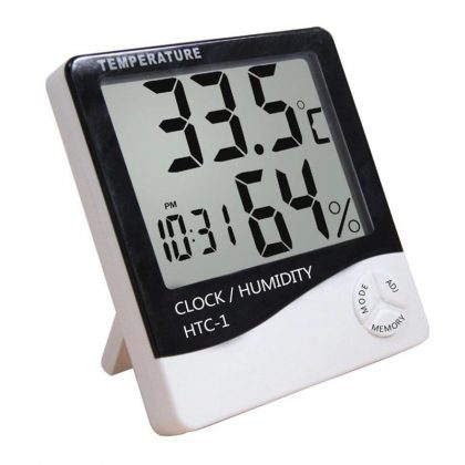 Ceas cu termometru și aparat măsurat umiditatea